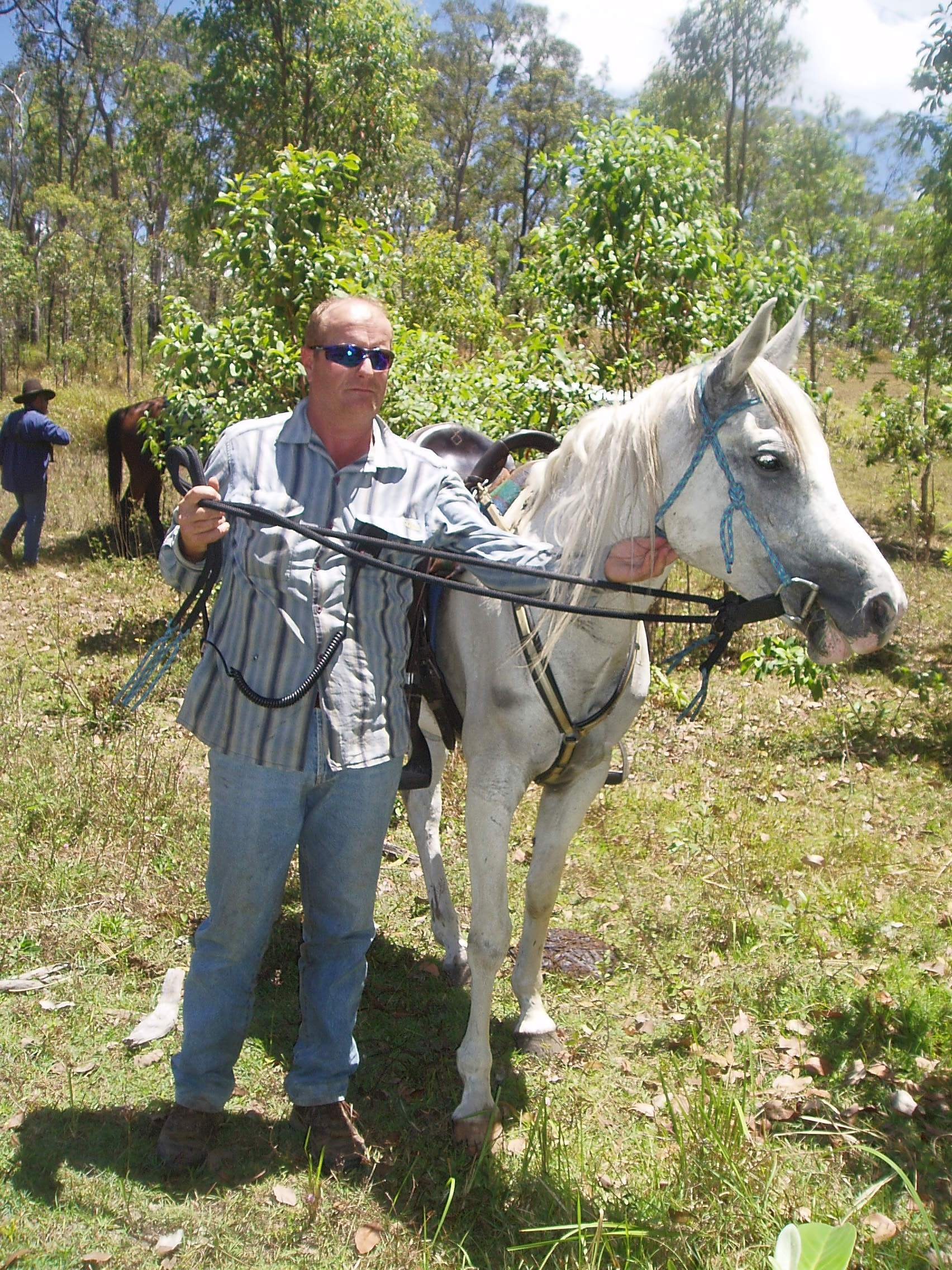 "Trailride Boss Michael Teuwsen and his horse ""Niarla Silver Flair"" take a moment to relax and have a break during the Teemburra Dam Trailride."